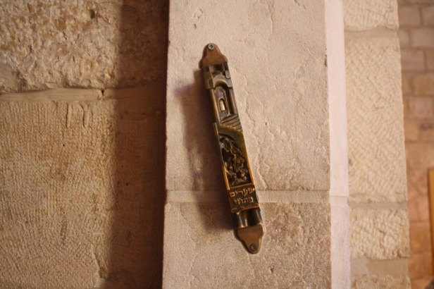 Mezuzah on the side of the doorway